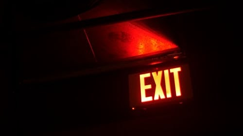 A Lighted Exit Sign For Direction