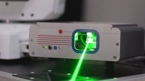Close-up Of A Machine With Moving Laser Light
