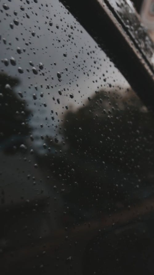 A Glass Window With Water Droplets