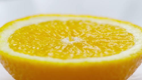 A Slice Of A Lemon Fruit In Focus