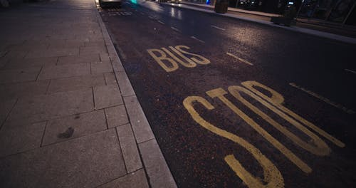 Bus Stop Sign Painted On The Road