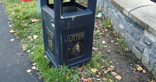 Blue Garbage Bin On The Street