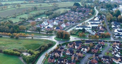 Aerial Footage Of A Community Near Farm Fields