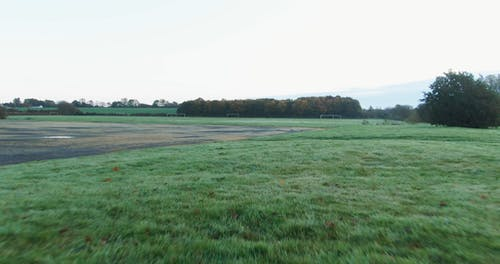 Drone Footage Of An Open Grass Field