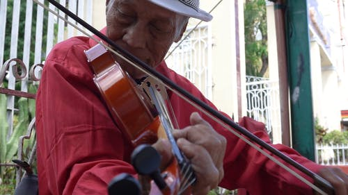 A Musician Playing The Violin