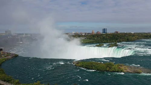 Mist Of Water  Is Rising Up From The The Force Of Niagara Falls
