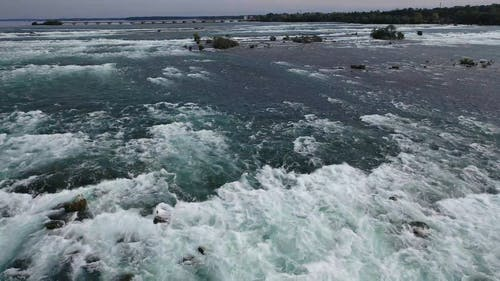The Strong Force Of The River Flowing In Niagara Falls