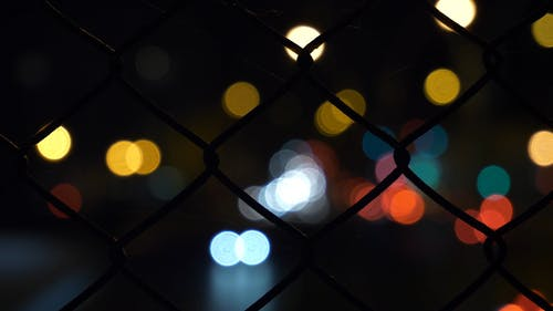Wire Fence With Lights On Background