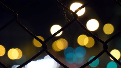 City And Motor Vehicles Lights As Backdrop In An Out Of Focus Footage
