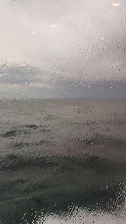 Sea Water Splash On A Water Craft Glass Window