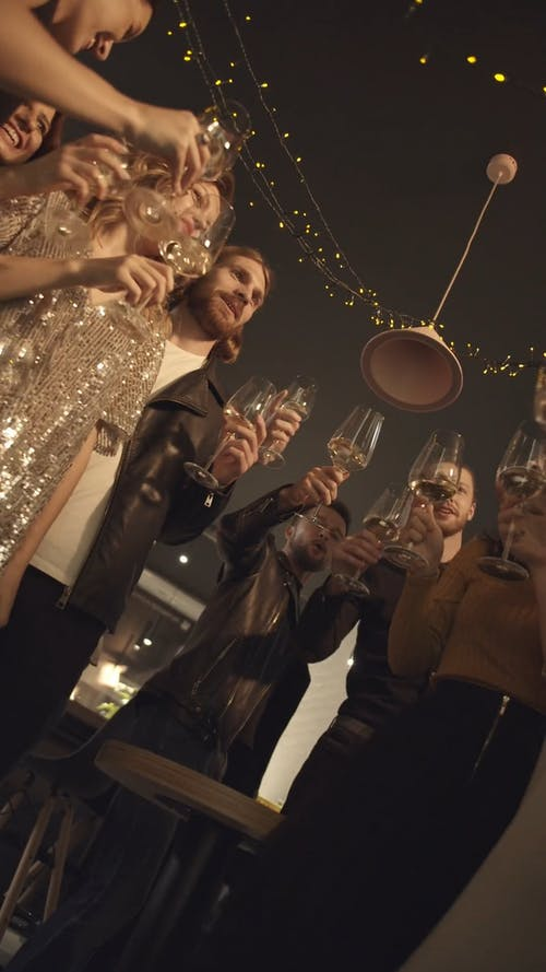 Group Of People In The Party Gathering For A Glass Toss In Unison