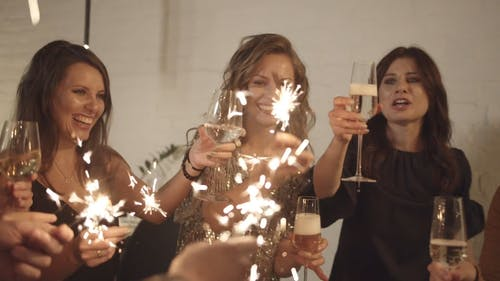Group Of Women Holding Sparklers