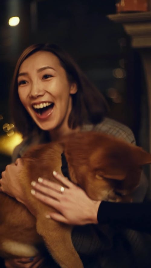 A Woman Grasping In Embrace A Pet Dog