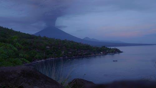 A Long Distance Shot Of An Erupting Volcano