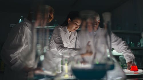 People In Happy Moods While working In A Laboratory