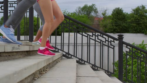 Three Women Jogging Down On A Stairs