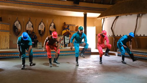 Men Performing A Traditional Dance Routine In South Africa