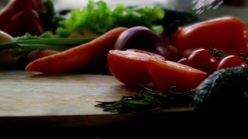 Sprinkle Of Rock Salt On Fresh Vegetables Over TheTable