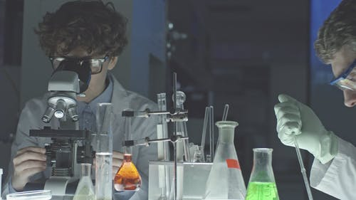 A Man And A Woman Doing Scientific Work Inside A Laboratory
