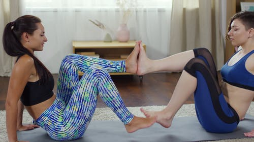 Two Women In A Synchronized Exercise Movements