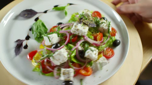 A Serving Of Vegetable Salad With White Cheese