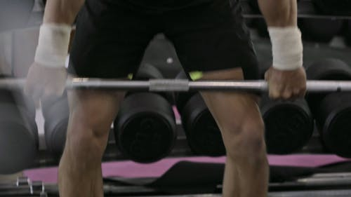 A Man Lifting Weights In A Fitness Gym