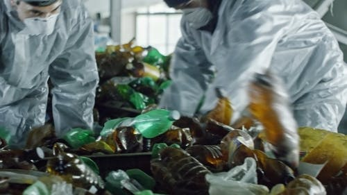 People Working In A Plastic Factory For Recycle