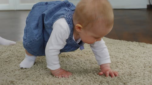 Baby Girl Crawling On The Floor