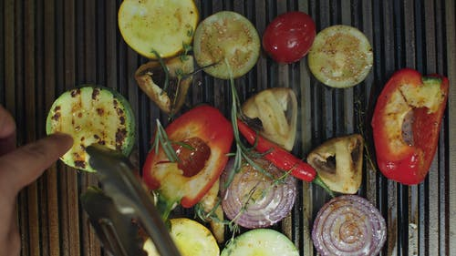 A Variety Of Vegetables Being Grilled