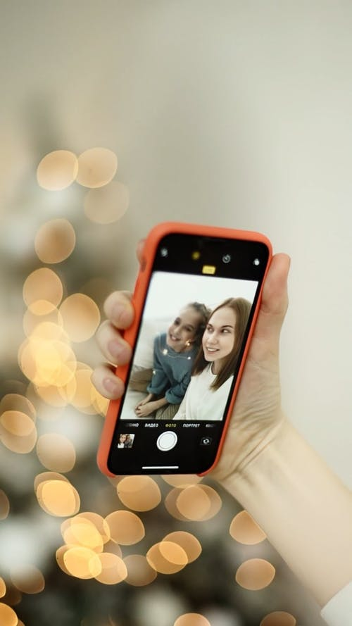 Video Recording Of A Mother And Daughter On A Smart Cellphone
