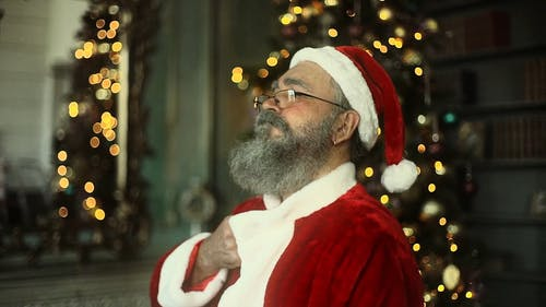 A Man Feeling Good In A Santa Claus Attire