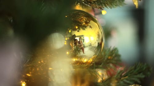 Santa Claus Reflection On A Christmas Tree's Ornaments Ball Decoration