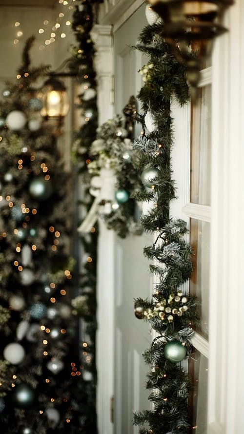 Santa Claus Leaves A Gift At A Door Entrance When Nobody Answers His Knocking