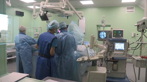 Group Of People In A Medical Field Inside An Operating Room