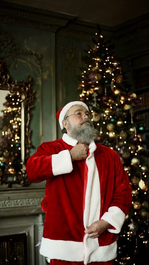 An Elderly Man Dressing Up As Santa Claus