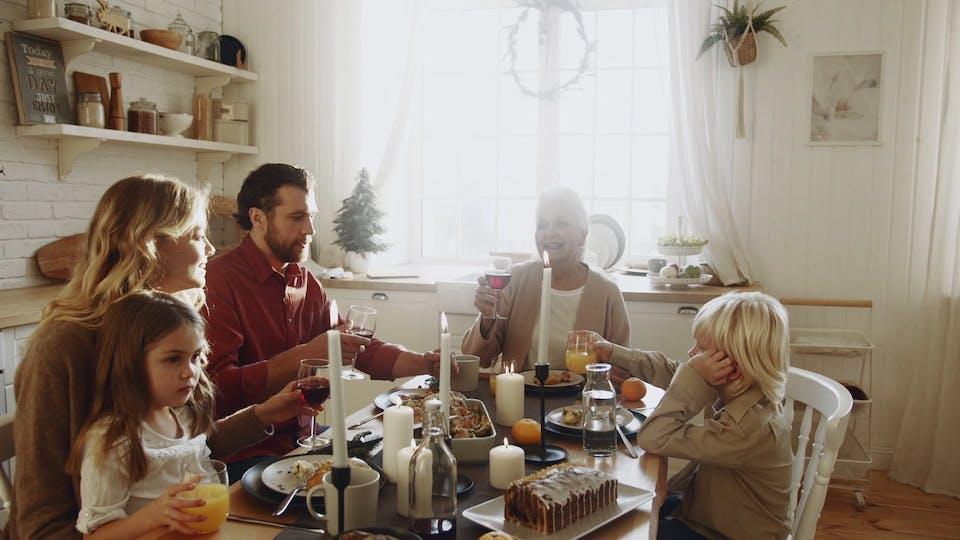 A Family Raise Their Glasses For A Toss On An Elderly Woman Inspirational Speech