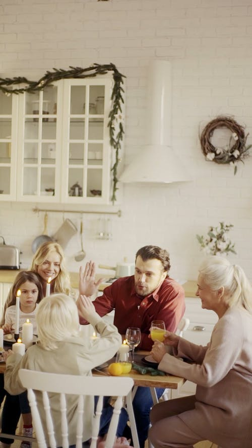 A Family Gathering In A Dining Table In A Happy Mood