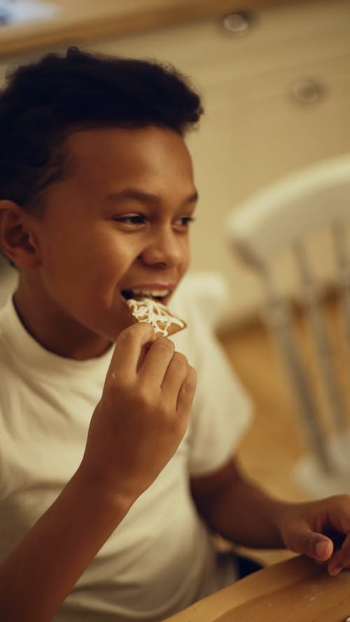 A Boy Eating A Cookie