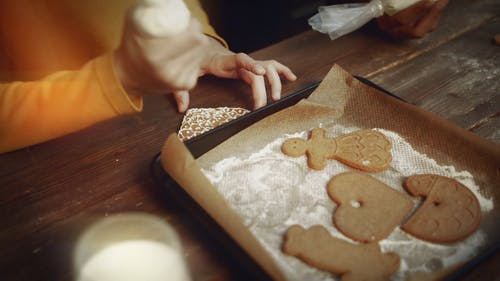 Kids Putting Icing Decors On Gingerbread Cookies
