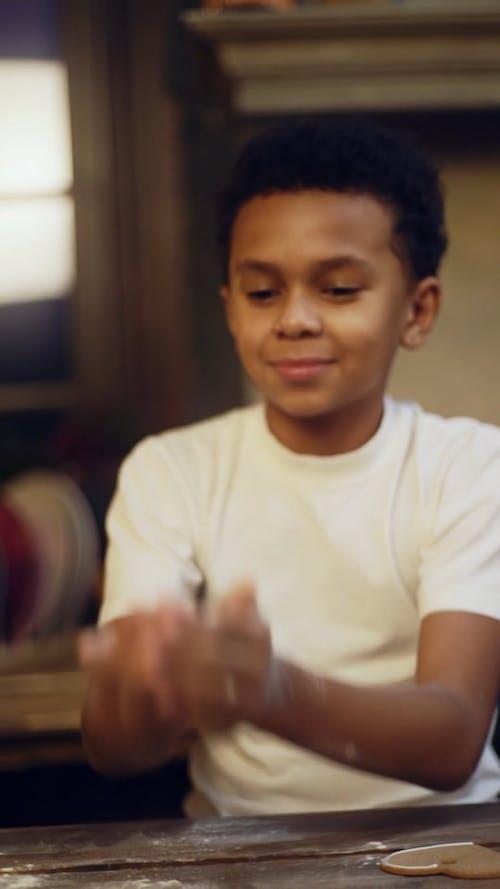 A Boy Playing With Powder Flour