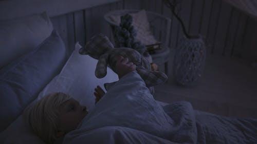 A Boy Having His Stuffed Toy Beside Him In Sleeping