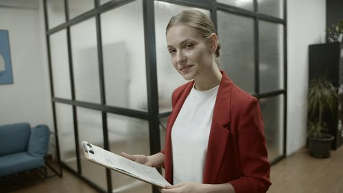 Woman With A Smiling Face While Working