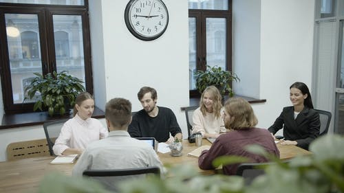 Group Of People In A Business Meeting In A Conference Room