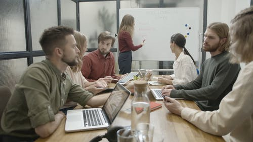 People In A Business Meeting Shares Information And Data With One Another