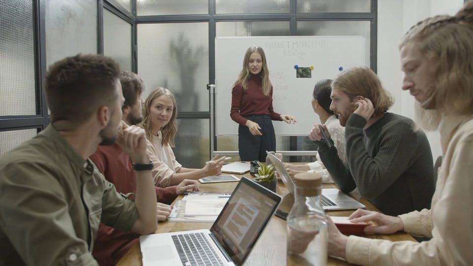 People In A Conference Room For A Business Meeting