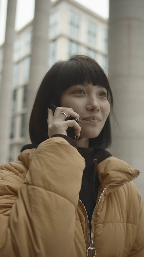 Portrait Of A Woman Talking Over The Phone