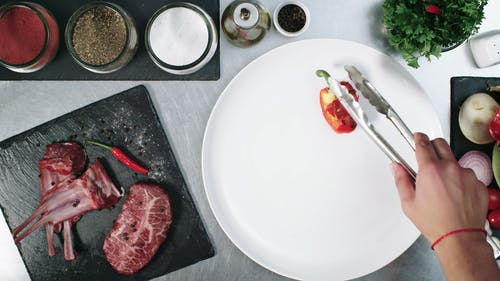 Plating Presentation Of Grilled Steak With Mixed Vegetables