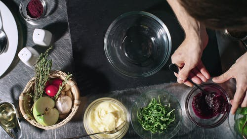 Mixing Mashed Vegetable In A Crystal Bowl