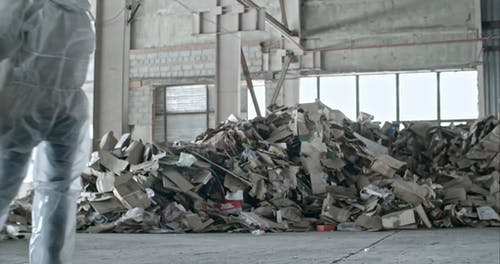 Trash And Debris Collected Inside a toxic Warehouse