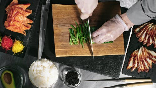 Cutting Cucumbers Into Long Thin Slices As Ingredient For Sushi Roll